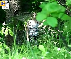 Chubby teen gets spycammed while peeing in the bushes
