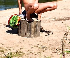 Exciting teen peeing naked near the lake