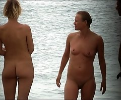 Several excited nudists get slyly filmed on a beach